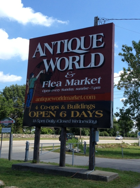 Antique World sign